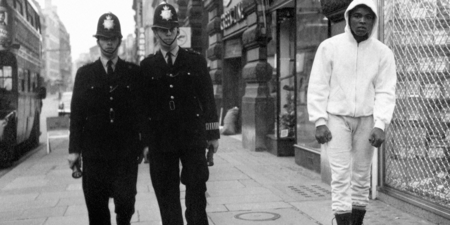 World heavyweight champion Muhammad Ali leaves his London hotel for early morning training in preparation for his title fight with Henry Cooper.