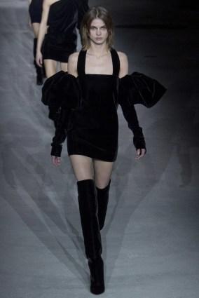 Dasha Khlystun walks in the Saint Laurent Paris runway show in a black dress