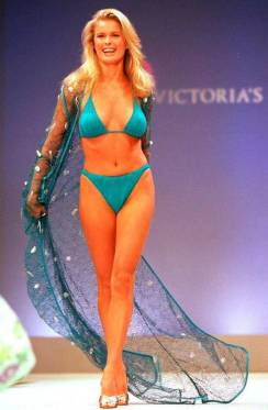 an image from the early days of the Victoria's Secret Fashion Show, a model wears a simple separates