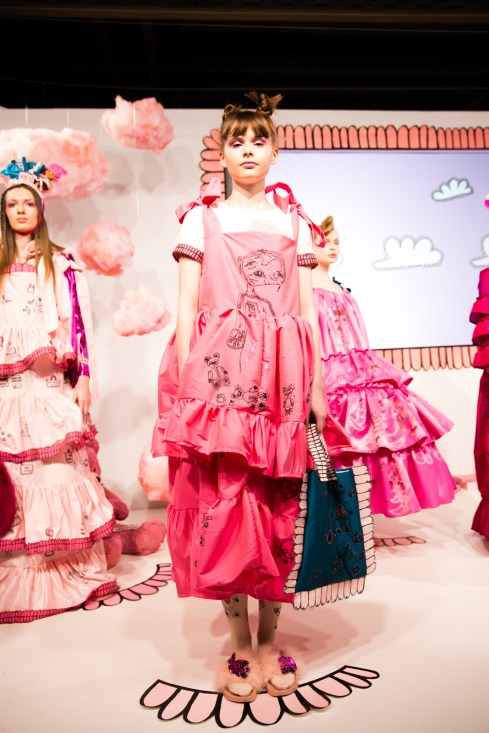 Amy Thomson FW18 Chasin' Dreams Presentation London Fashion Week, a model wearing an oversized fuschia dress