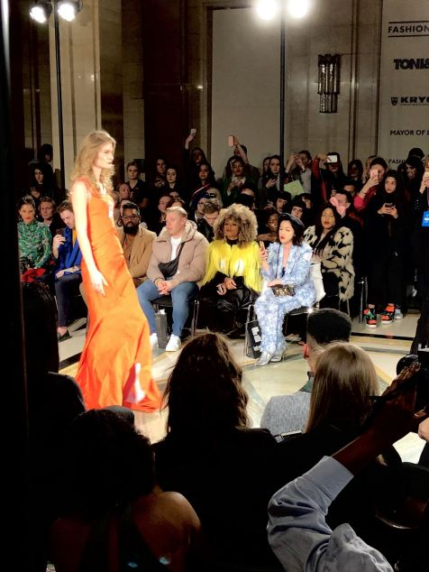 Malan Breton FW18 Fashion Scout London Fashion Week Lead a model wearing an amber coloured dress