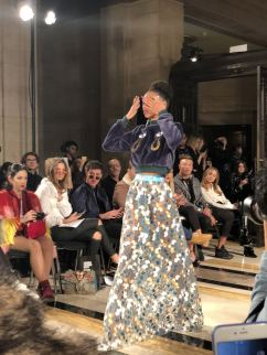 STARSICA FW18 LONDON FASHION WEEK a model in a full floor length patterned skirt covering her eyes