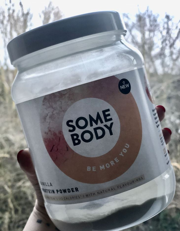 A close up of an almost empty tub of protein powder from the Superdrug Some Body range of supplements