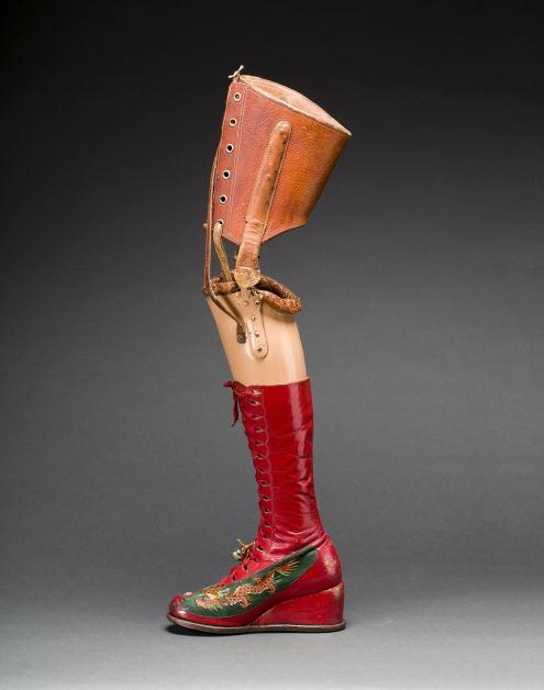 Prosthetic leg with leather boot. Appliquéd silk with embroidered Chinese motifs. Photograph Javier Hinojosa. Museo Frida Kahlo. © Diego Riviera and Frida Kahlo Archives