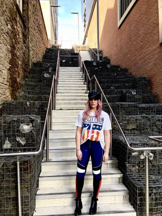 Pixie tenenbaum wearing the GIGI x TOMMY leather speed motocross style pants with a Led Zepplin tee and a baker boy hat.