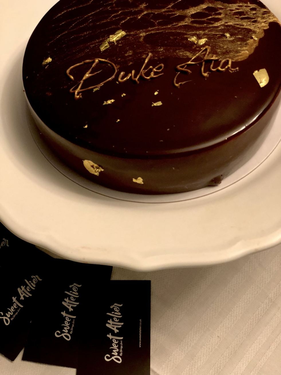 """A personalised cake with the words """"Duke Ata"""" prepared by Sweet Atelier for the Duke Ata Clubhouse launch event"""