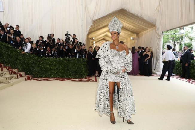 Rihanna on the steps of the Met Gala costume institute Ball for 2018 wearing a jewelled Balmain gown