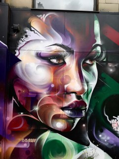 Street Art in Shoreditch: A woman's face painted in galaxy swirls