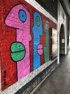 Street Art in Shoreditch: Barrio Subway faces