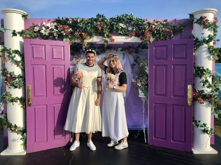 Comedy Central UK's Friends fest 2018: Pixie Tenenbaum and her brother wearing the wedding dresses from the hit TV show friends and posing in a giant picture frame