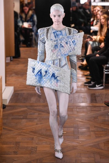 A typical Balmain style dress with exaggerated side panels at the Spring 2019 runway show in Paris