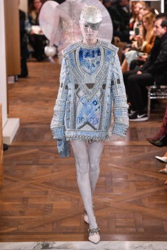 Typical Balmain styling at Balmain's first couture runway show for Spring 2019 in Paris. Tunic dress with beading