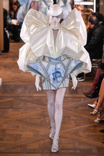 An image of a runway model at the Balmain couture Spring 2019 show wearing a huge blue and cream outfit