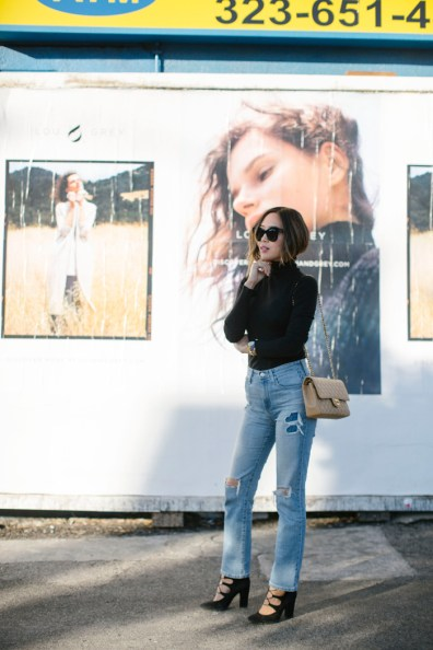 aimee_song_of_style_lightwash_distressed_jeans_black_turtleneck
