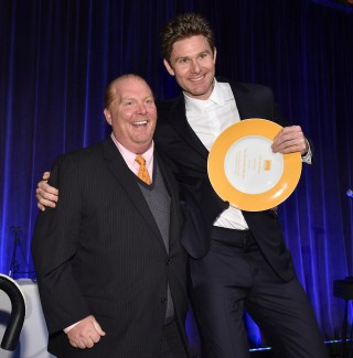 """""""NEW YORK, NY - APRIL 20: Chef Mario Batali presents an award to honoree Dan Colen on stage at the Food Bank Of New York City's Can Do Awards 2016 hosted by Michael Strahan and Mario Batali at Cipriani Wall Street on April 20, 2016 in New York City. (Photo by Bryan Bedder/Getty Images for Food Bank of New York City)"""""""