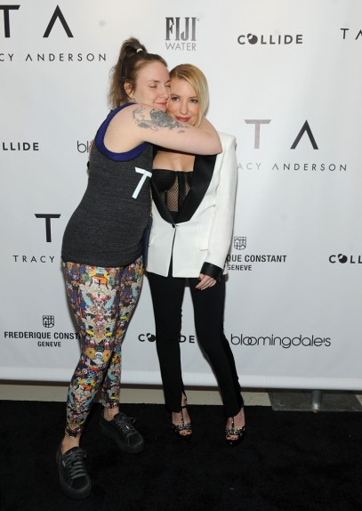 Lena Dunham gives a hug to Tracy Anderson at the opening party of the Tracy Anderson 59th Street studio, Wednesday, March 15, 2017 in New York. (Photo by Diane Bondareff/Invision for Tracy Anderson/AP Images)