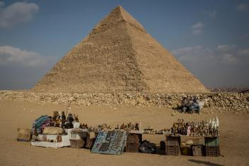 CAIRO, EGYPT - DECEMBER 18: Men selling souvenirs at Egypt's famous Giza Pyramids wait for customers on December 18, 2016 in Cairo, Egypt. Since the 2011 Arab Spring and continued terrorist attacks throughout the country, Egypt's tourism industry has been hit hard. As the country tries to rebuild a damaged economy and revive the tourism industry, an increase in terrorists attacks in the past two weeks, one which targeted police officers at a checkpoint in the Giza neighbourhood, could continue to see the tourism industry suffer. (Photo by Chris McGrath/Getty Images)