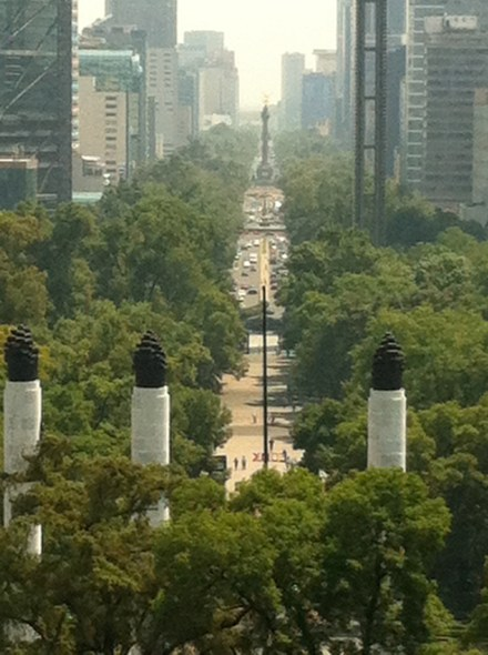 View from the castle to downtown and the Angel of Independence at the end of the boulevard.  Note the monument columns  to the Cadet Heroes in the foreground