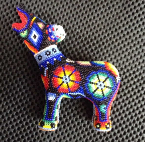 Little wolf left side- red and blue peyote seeds