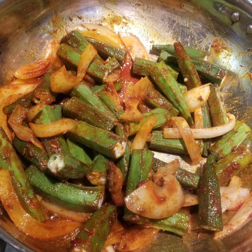 add okra and stir well