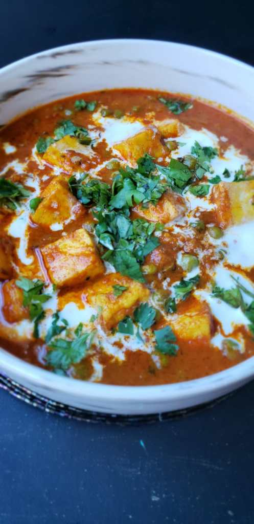 transfer matar paneer to a serving bowl