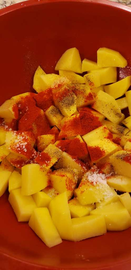 add spices to the potatoes