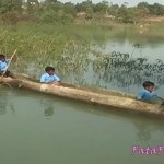 Children forced to cross the river by boat