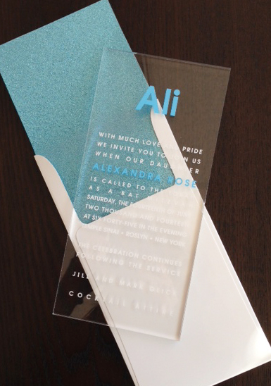Aqua Glitter Lucite by Lemontree, Clear lucite Mitzvah invitation with blue and white text, blue glitter envelope liner