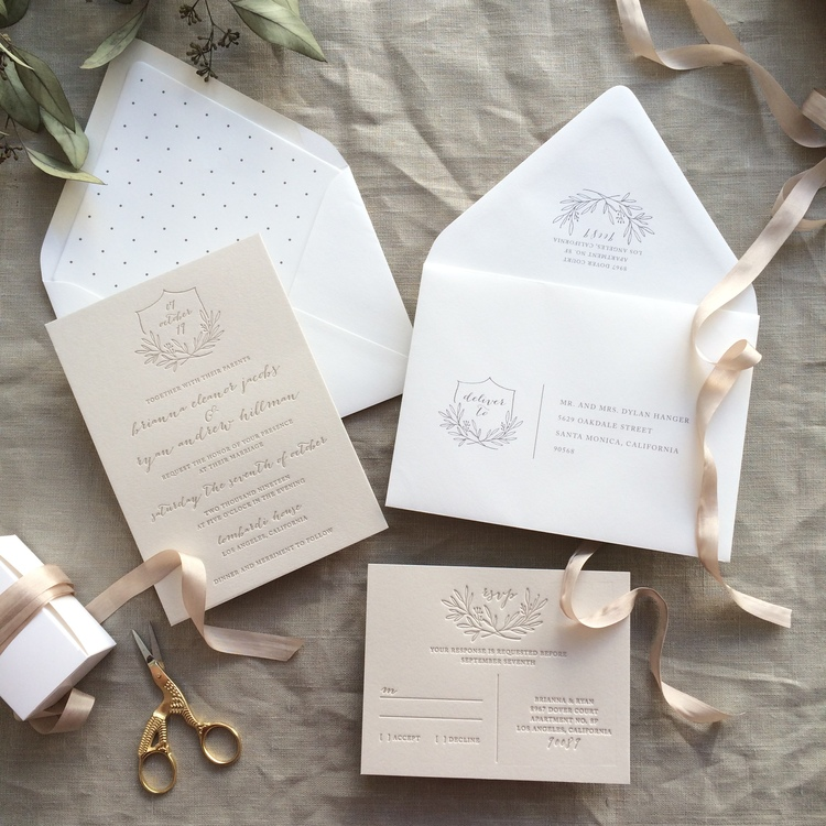 Brianna by B.T.Elements, Taupe wedding invitation with monogram crest and laurel, whimsical calligraphy style script, polka dot envelope liner