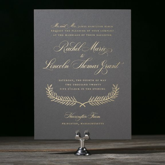 Estate by Bella Figura, gold foil on charcoal paper, wedding invitation with laurel, traditional fonts, script, cursive, classic, gray paper