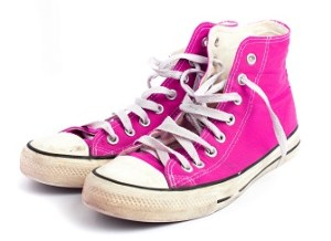 A pair of hot pink converse high top sneakers