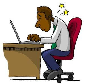Man sitting at office desk demonstrating poor posture