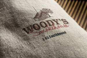 Woody's Smokehouse logo mockup