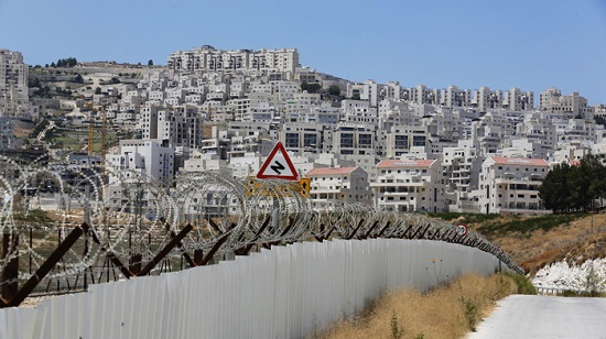A section of the controversial Israeli barrier is seen close to a Jewish settlement near Jerusalem