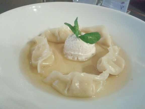Gorgeous, unique dessert of white chocolate dumplings with vanilla ice cream in cinnamon broth