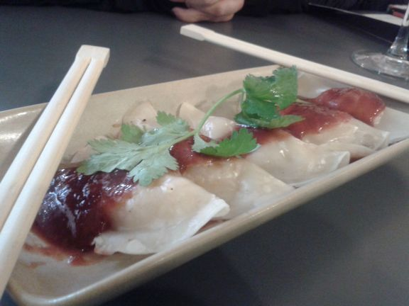 Sauerkraut dumplings with spicy plum sauce