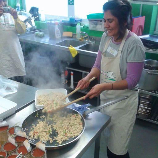 Nishma of Shambhu's serving Soyfoods tofu and prepping Mr Organic baked beans