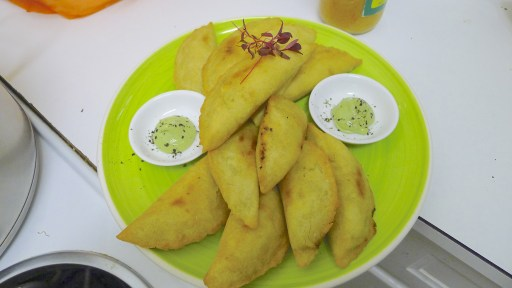 Spicy potato & callaloo corn empanadas with Trinidadian coconut chutney & hot Bajan chutney