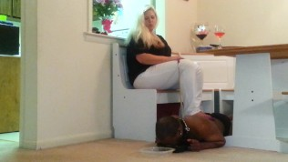 slave boy eating off the floor under his Goddess feet
