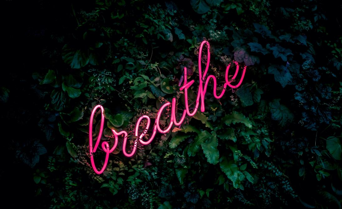 Neon sign that says Breathe