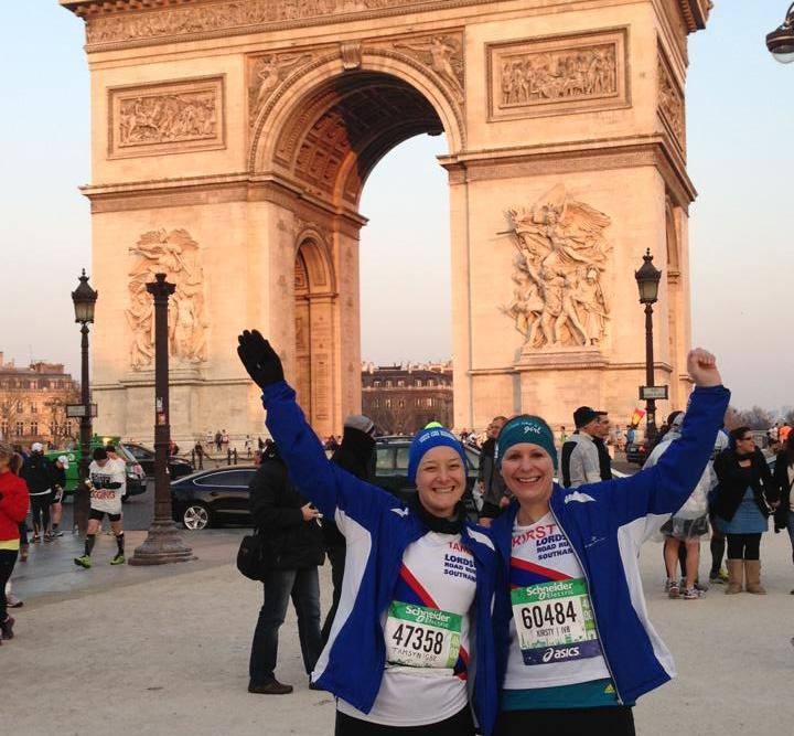 Tamsyn and Kirsty in front of L'Arc de Triomphe before Paris Marathon