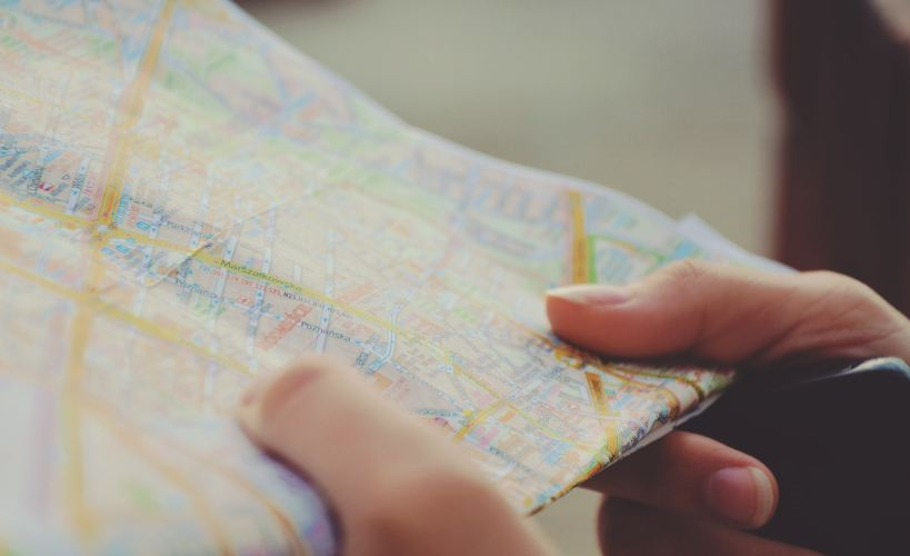Close up of someone holding a map