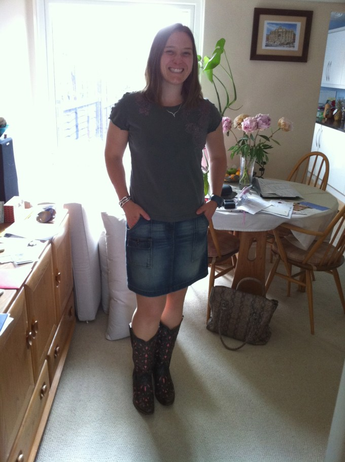 Tamsyn wearing a denim skirt and a pair of pink and black cowboy boots