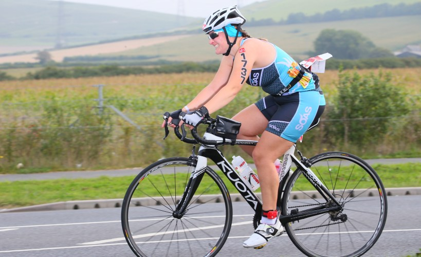 Tamsyn on her bike during Weymouth Half.