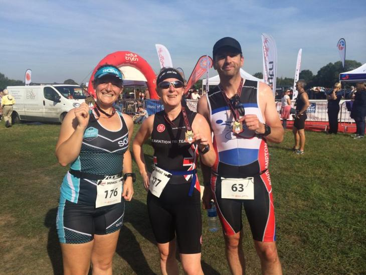 Tamsyn, Teri and James with their medals.