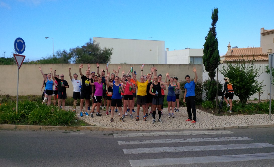Runners waving at the camera after Hell on the Hills workout.