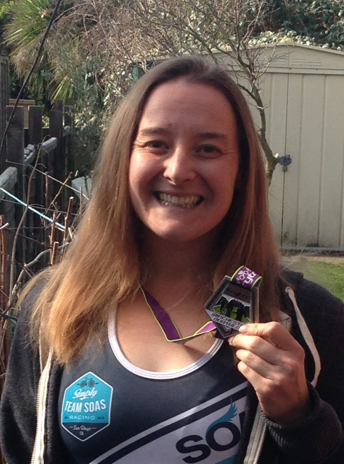 Tamsyn holding her Winchester Duathlon medal