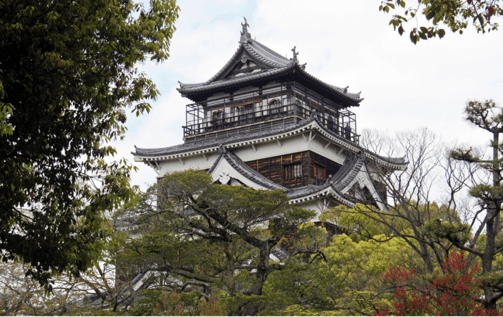 Hiroshima Castle - a traditional style castle made of brown wood.