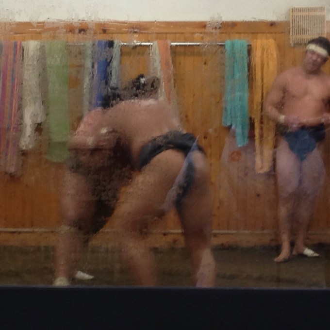Men wrestling at a sumo stable