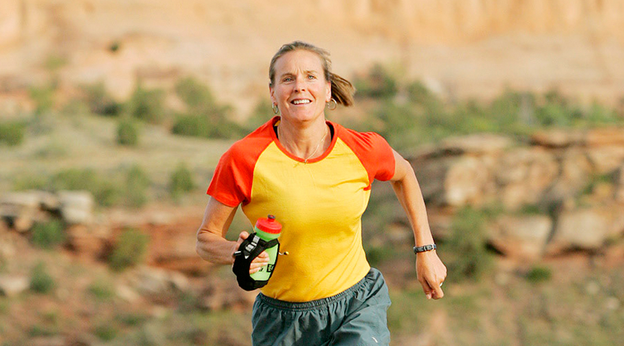 Lisa Smith-Batchen running and smiling.